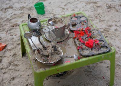 utensils on sand pit